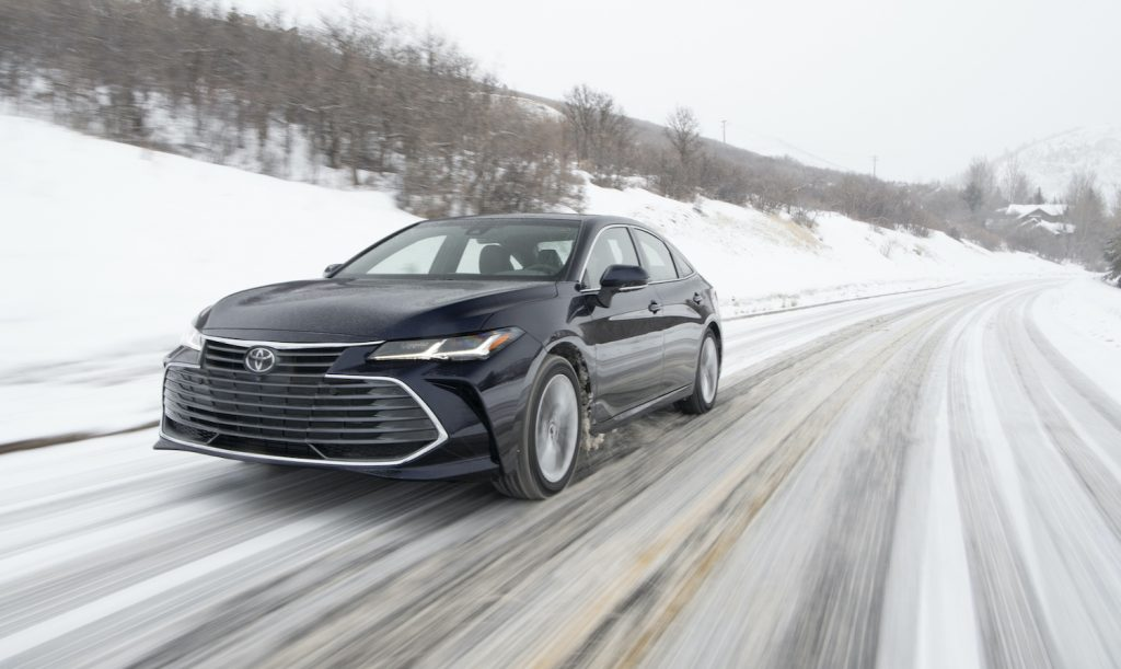 The 2021 Toyota Avalon driving down a snow covered road