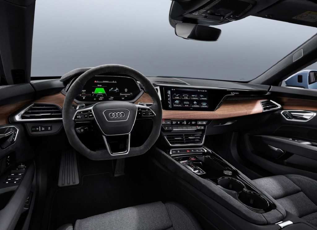 The black front seats and brown-wood dashboard of the 2022 Audi E-Tron GT Quattro