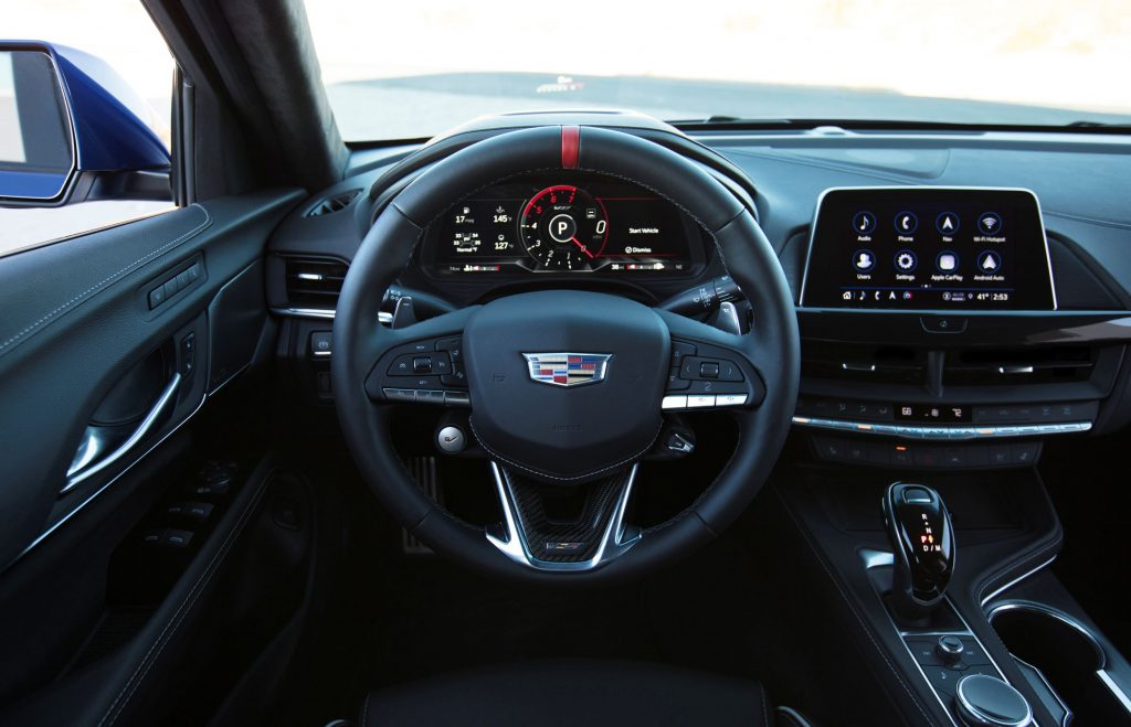 The driver's seat, gauge cluster, and dashboard of the 2022 Cadillac CT4-V Blackwing