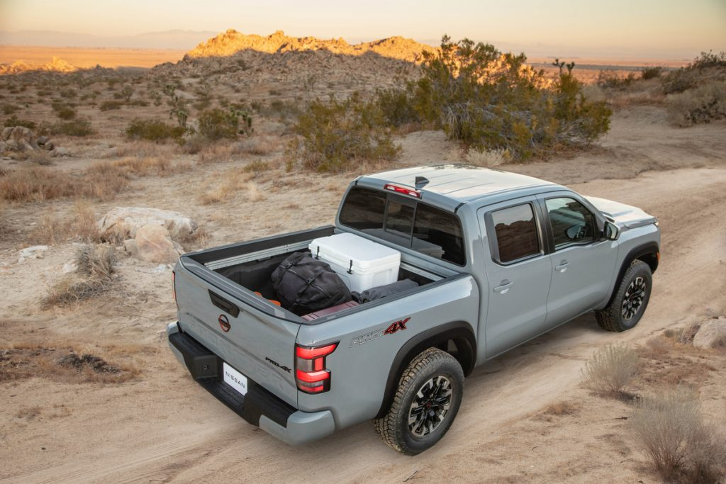 A light gray 2022 Nissan Frontier with a full truck bed shot from above
