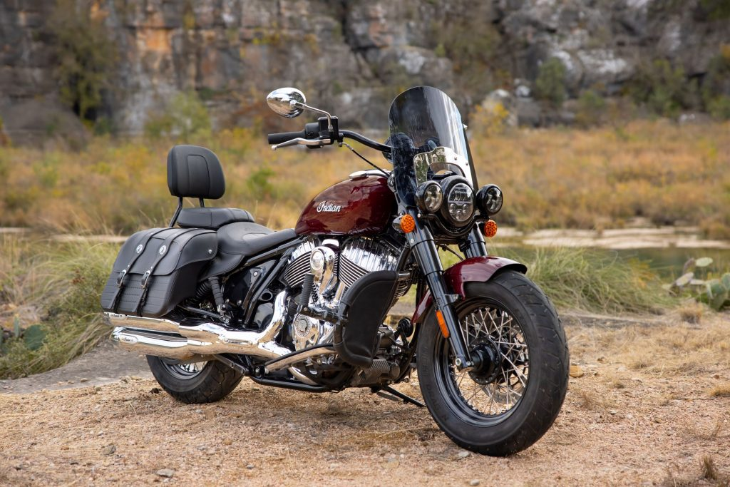 A maroon-and-black 2022 Indian Super Chief Limited by a desert lake