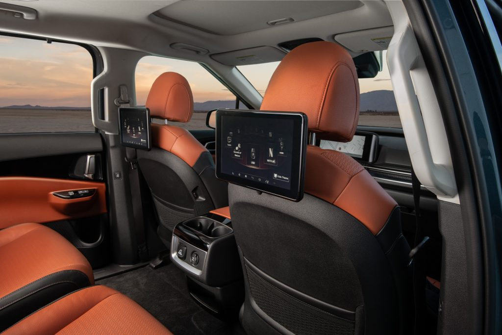 A look at the interior of the 2022 Kia Carnival, which has available leather seats and a dual-screen rear seat entertainment system
