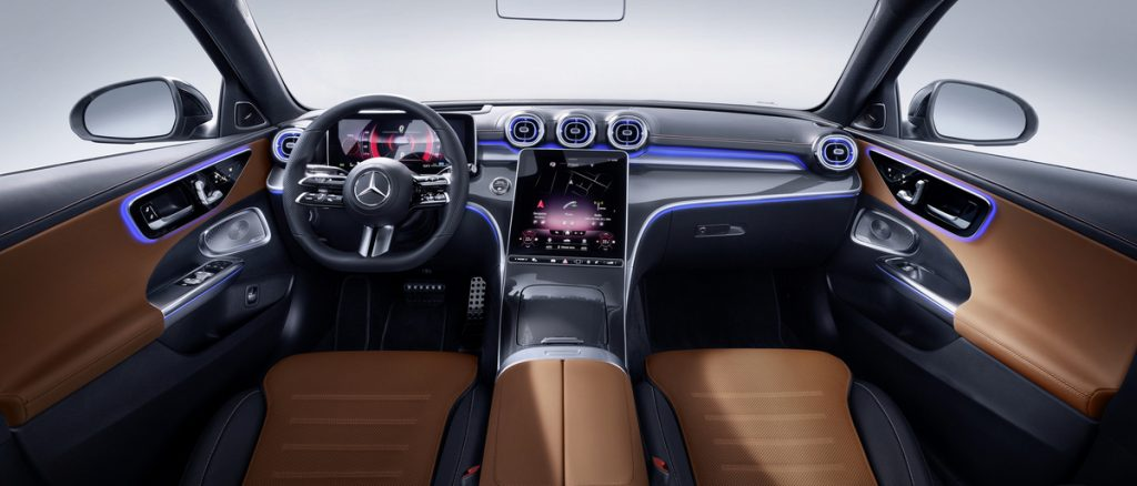 Brown and black interior of the 2022 Mercedes-Benz C-Class, a view of the front seats and dashboard