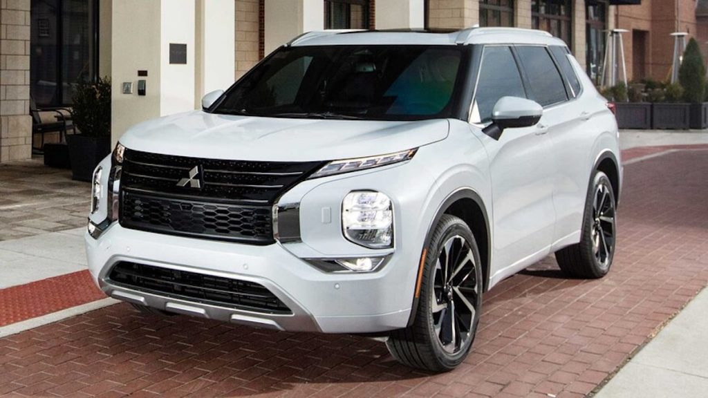 2022 Mitsubishi Outlander in white parked on brick road