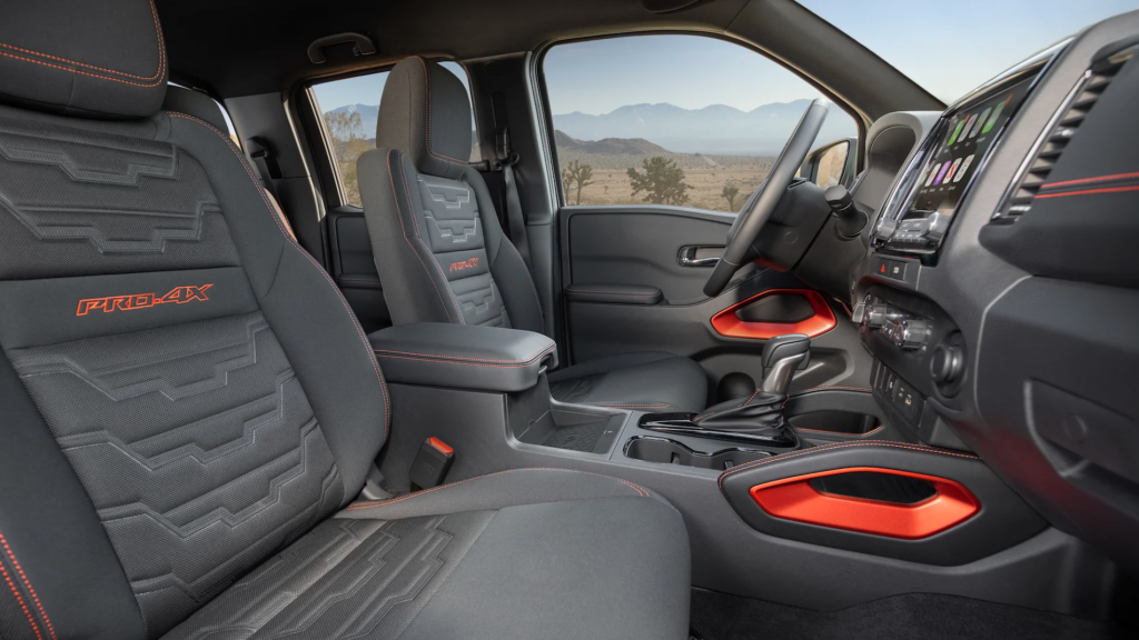An interior shot of the 2022 Nissan Interior with red and black color scheme