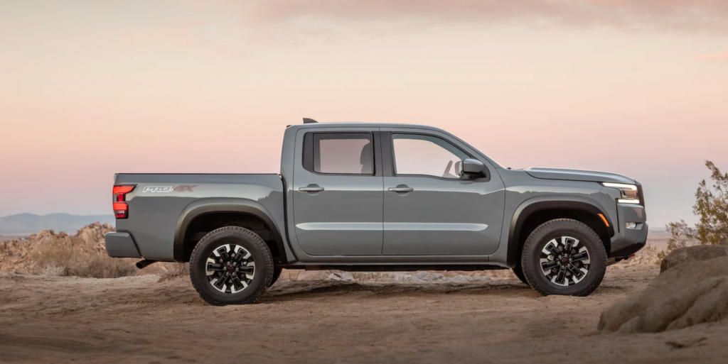 Gray 2022 Nissan Frontier parked in the desert at dusk