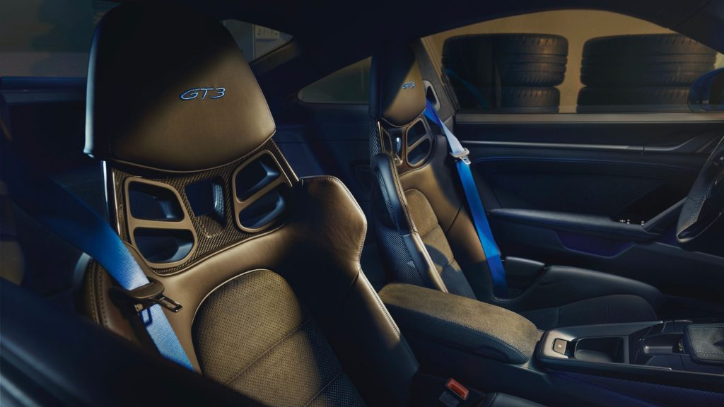 The 2022 Porsche 911 GT3's blue-trimmed optional carbon-fiber seats