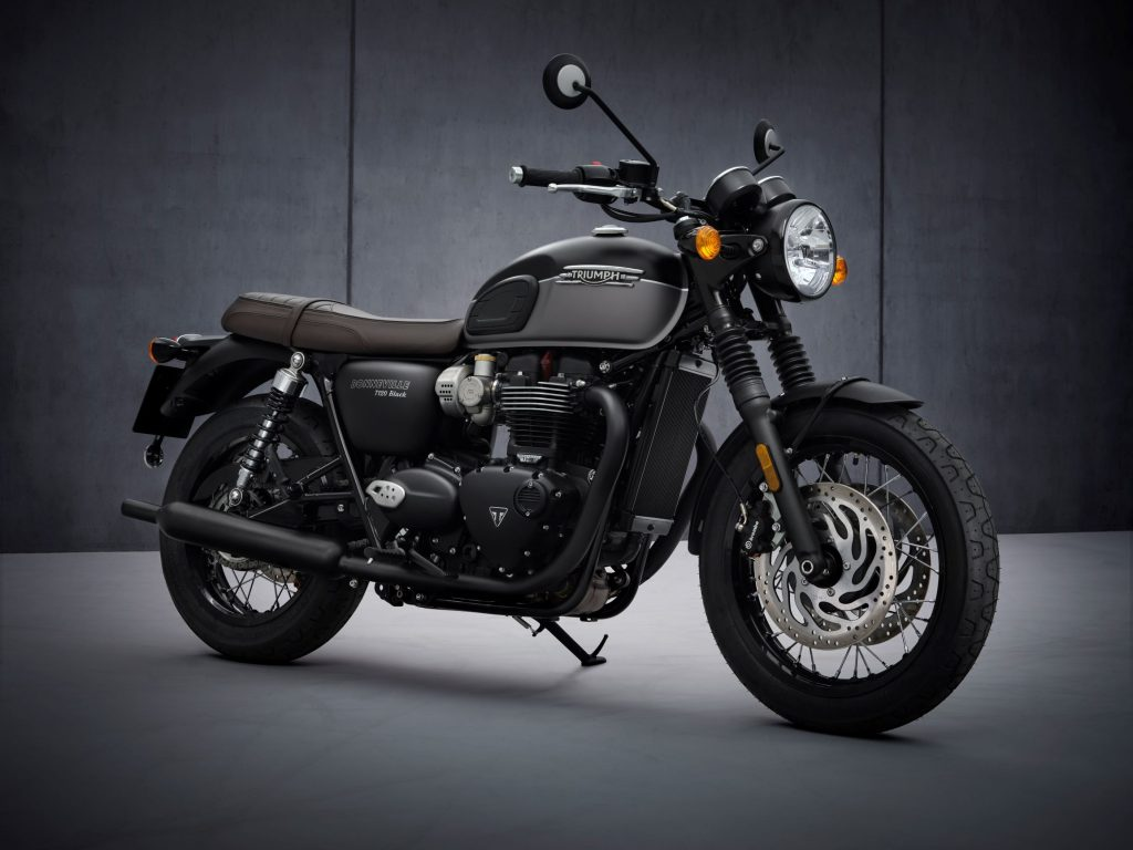 The matte-black-and-gray 2022 Triumph Bonneville T120 Black in front of a gray background