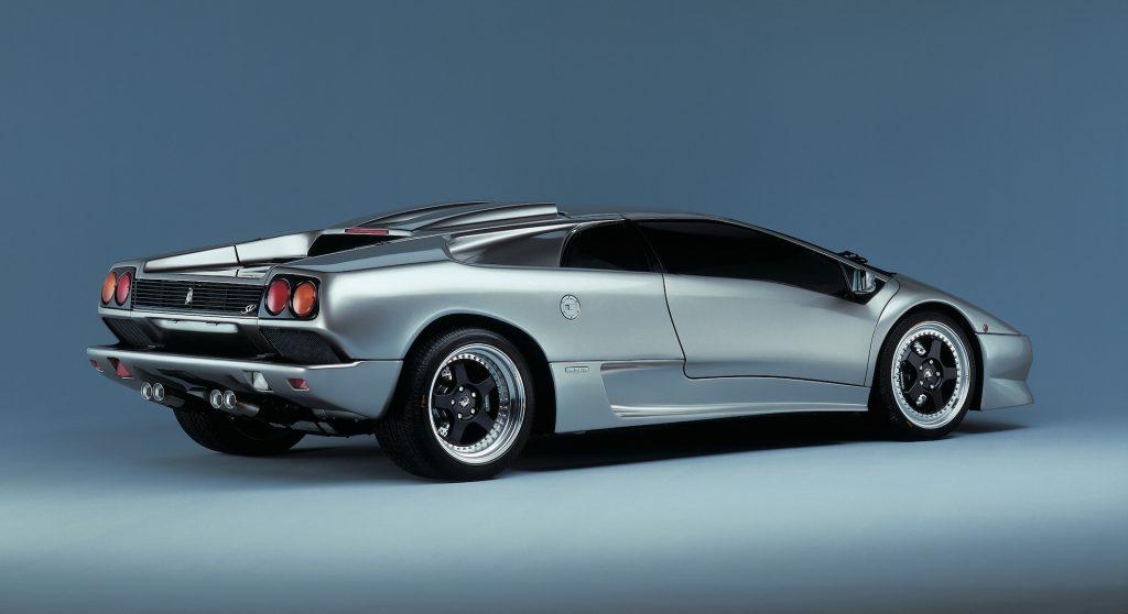 An image of a gray Lamborghini Diablo SV in a studio.