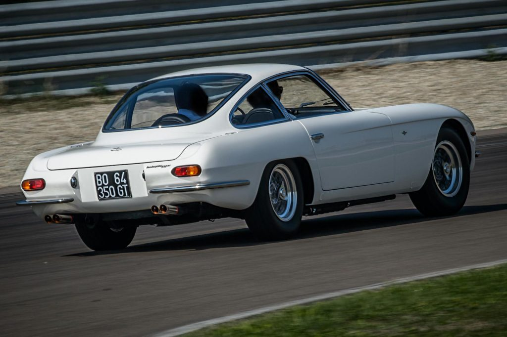 An image of a Lamborghini 350GT driving around on a track.