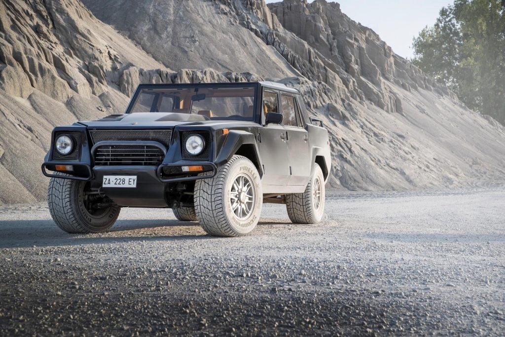 An image of a Lamborghini LM002 out on the road.