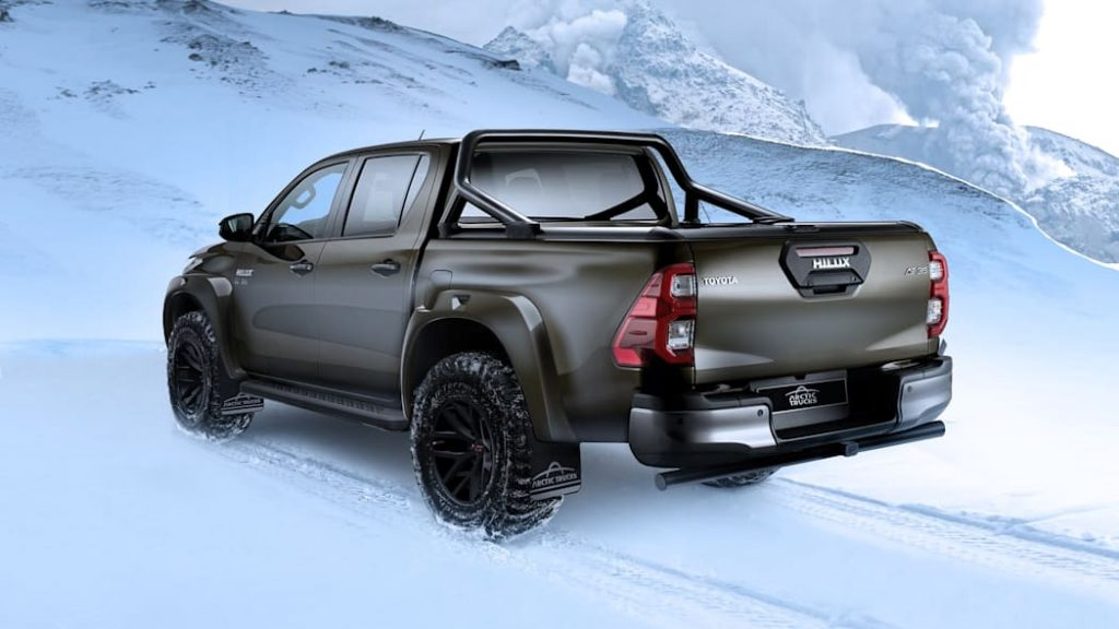 a rear three-quarter view of the Arctic Truck AT35 Toyota Hilux in the snow