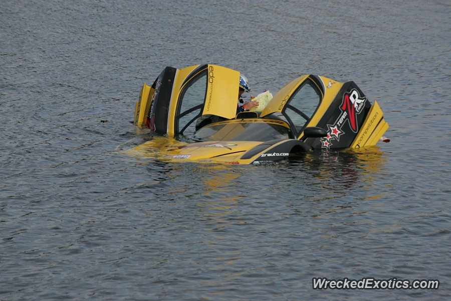 An image of a Ferrari Enzo FXX stuck in a lake.
