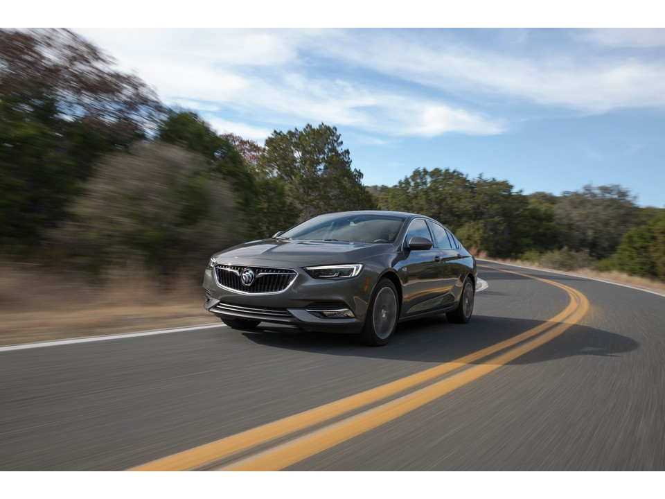 2020 Buick Regal luxury car at speed on a scenic road
