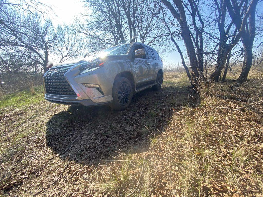 a metallic gray 2021 Lexus GX crawling down a muddy hill on wintery off-road trails.