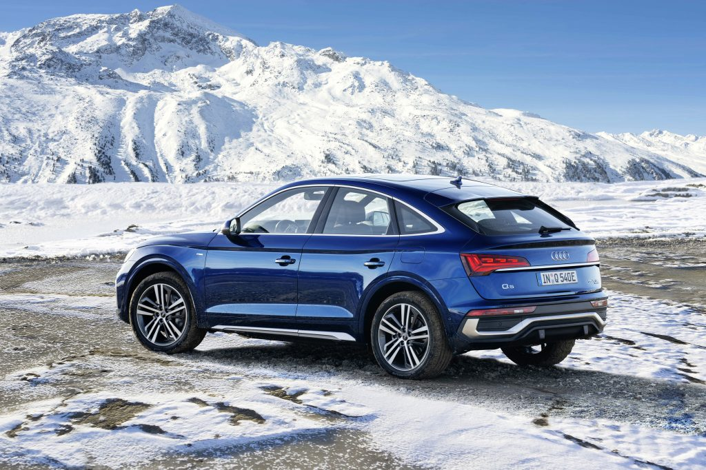 A 2021 Audi Q5 Sportback 55 TFSI e quattro in Navarra blue parked on an icy landscape
