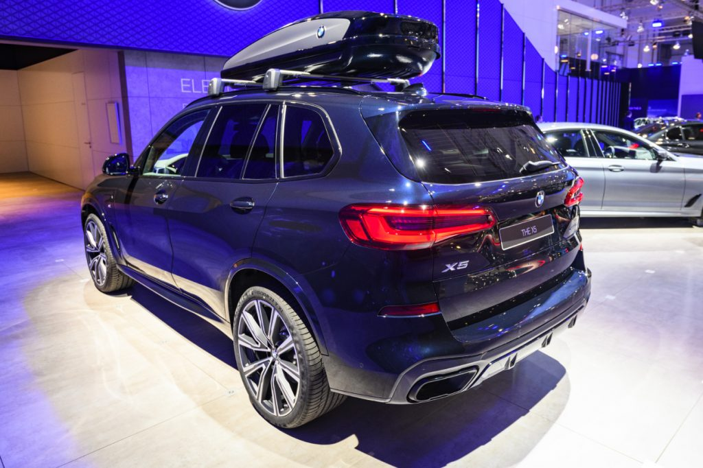 A blue BMW X5 SUV on display at an auto show