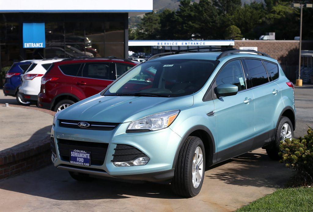 A used 2013 Ford Escape on a dealership lot