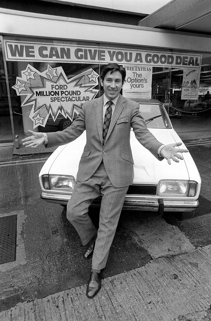 Shady-looking car salesman in black and white image