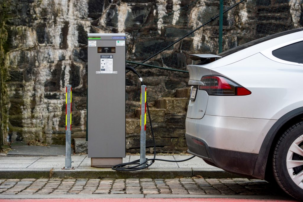 A Tesla is plugged in to an electric vehicle charger in Stavanger, Norway