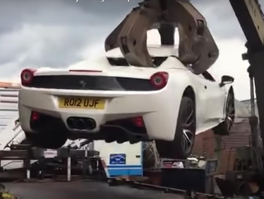 Crushed 458 Ferrari in scrap yard claws