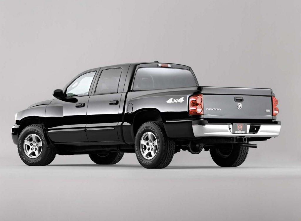 An image of a black 2005 Dodge Dakota parked inside of a photo studio.