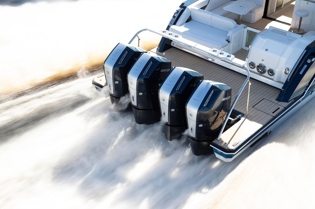 an elevated view of a boat at speed running four verado outboard motors