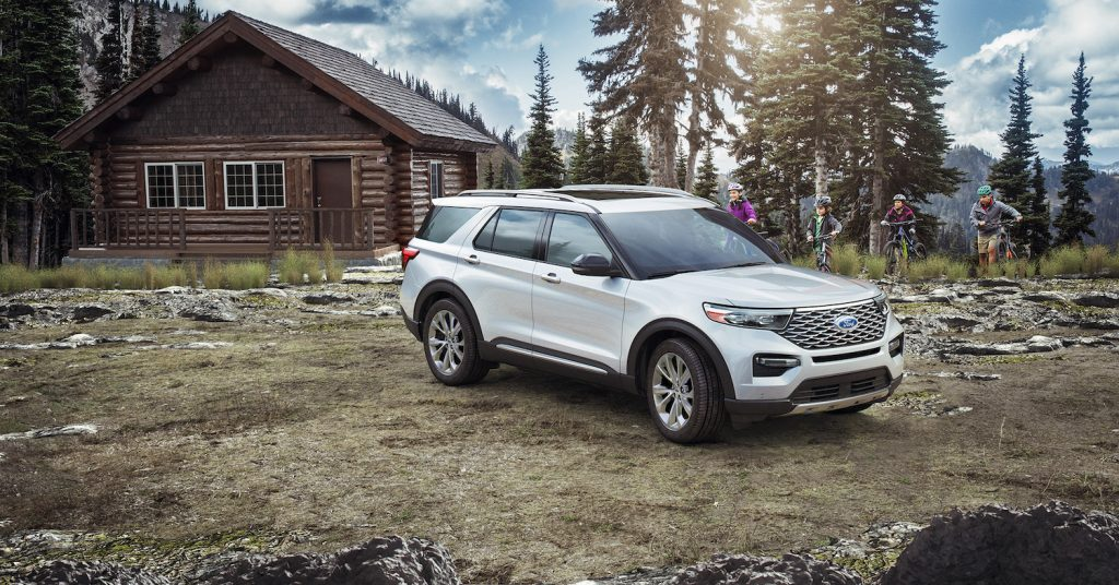 The 2021 Ford Explorer parked in front of a cabin