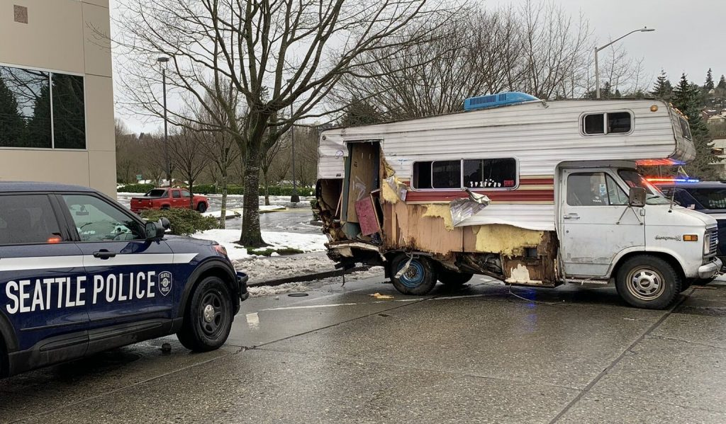 the Seattle Police Department spaud car squaring off with the RV driver in the middle of the street