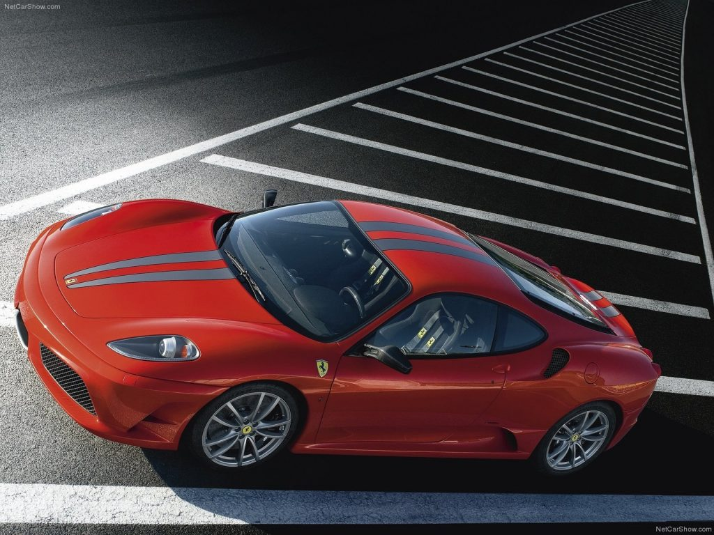 An image of a Ferrari F430 Scuderia out on track.