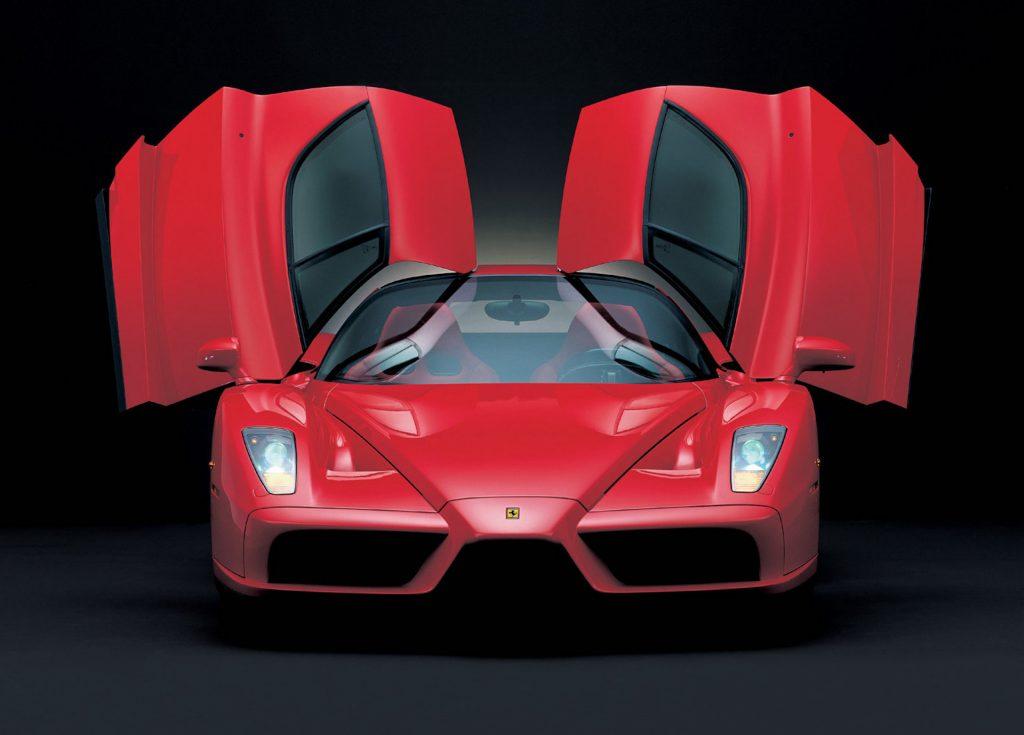 A digital image of a Ferrari Enzo in a black studio.