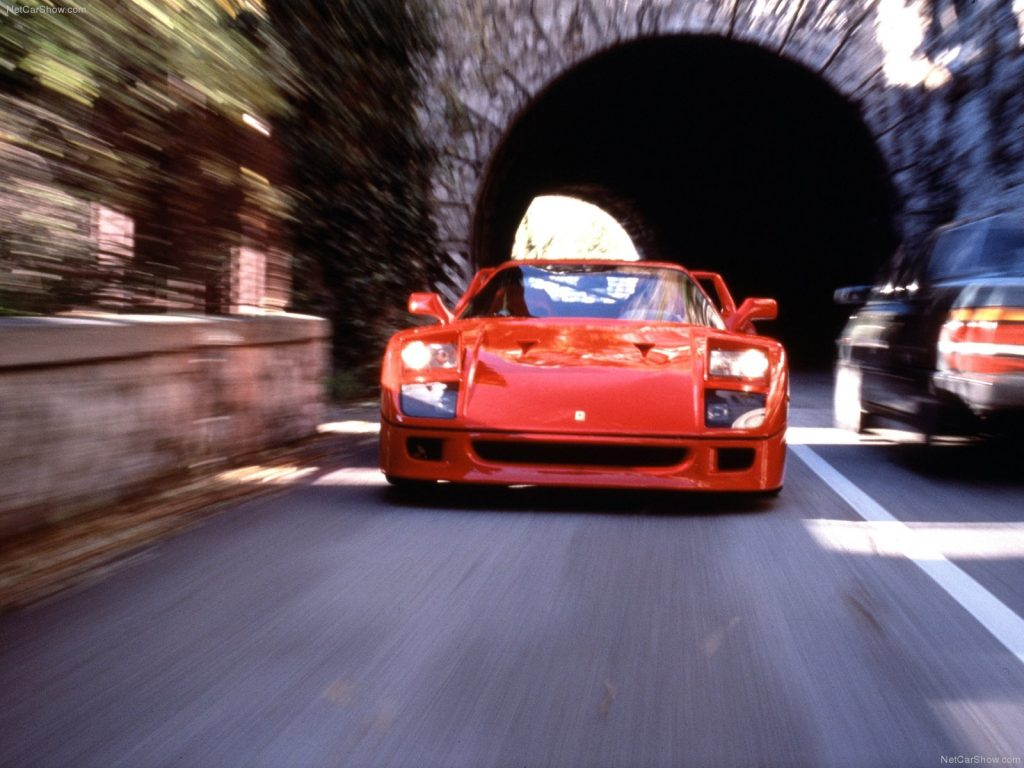 An image of a red Ferrari F40 outdoors.