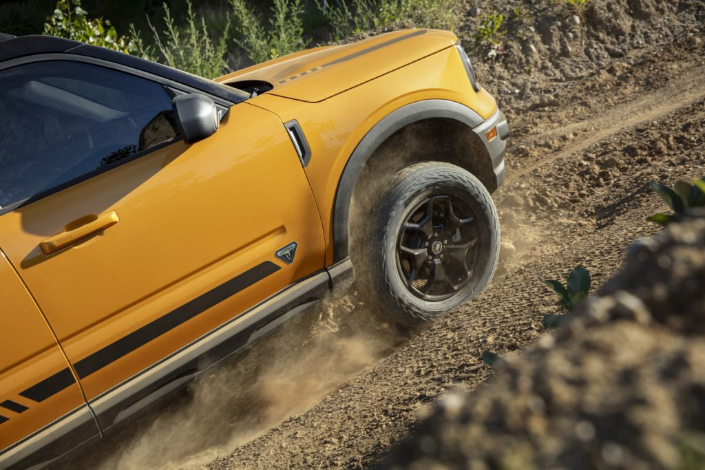 Yellow 2021 Ford Bronco Sport driving uphill