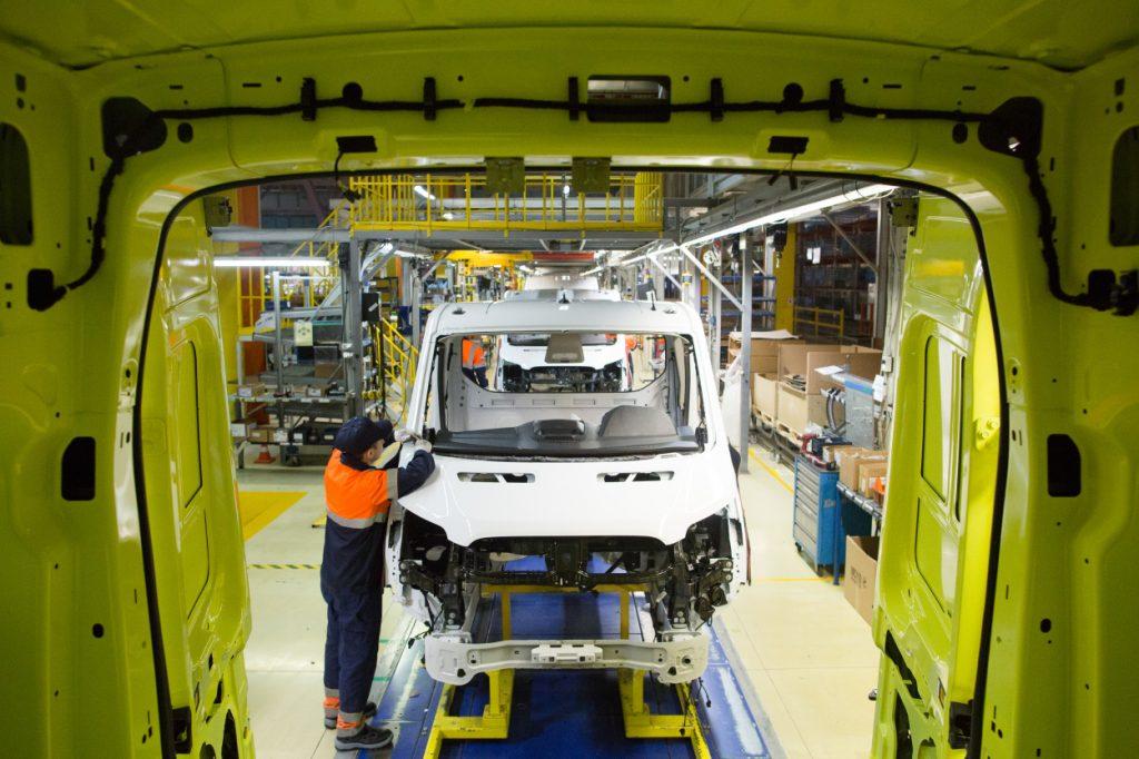 A worker assembles a Ford Transit van