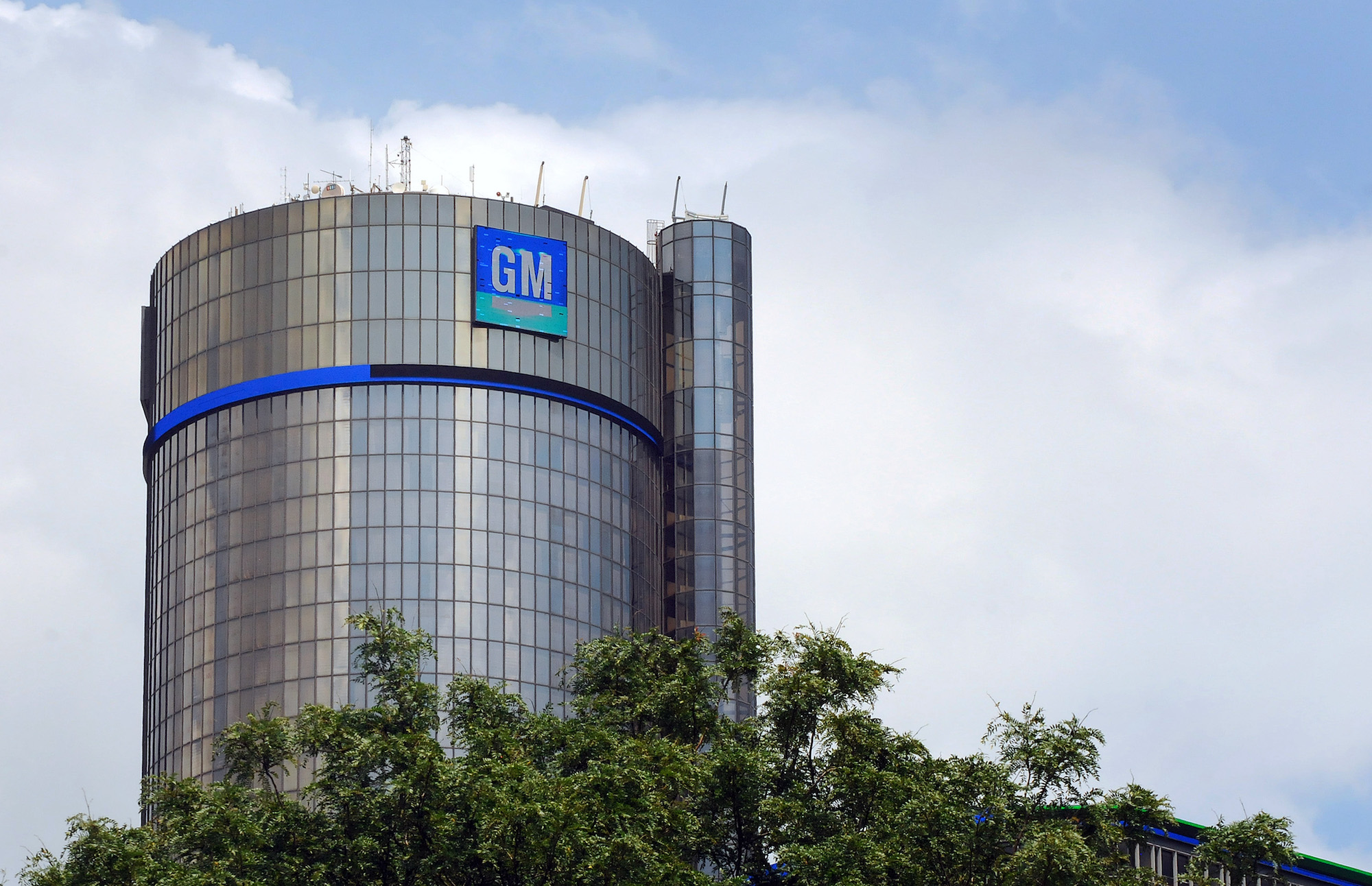 the General Motors headquarters building with a large GM logo on the side
