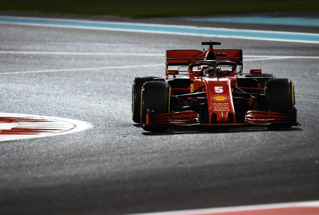 Sebastian Vettel taking a corner on F1 track in a Ferrari car