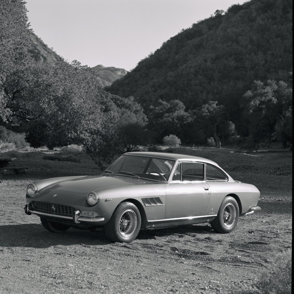An image of a Ferrari 330 parked outside.