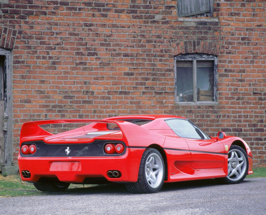 An image of a Ferrari F50 parked outside.