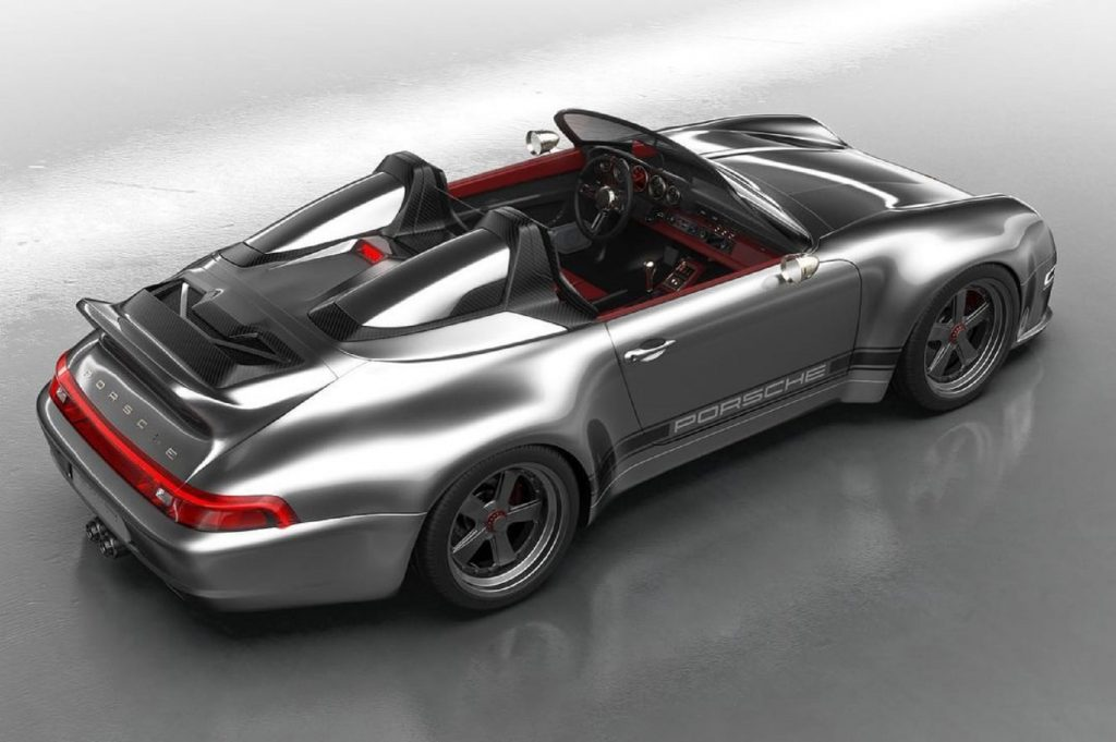 The overhead rear 3/4 view of a silver Gunther Werks 993 911 Speedster with a red interior