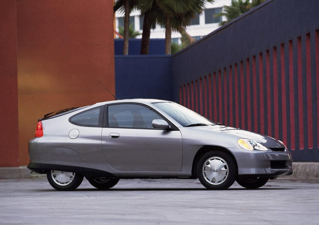 A silver 2000 Honda Insight  posing