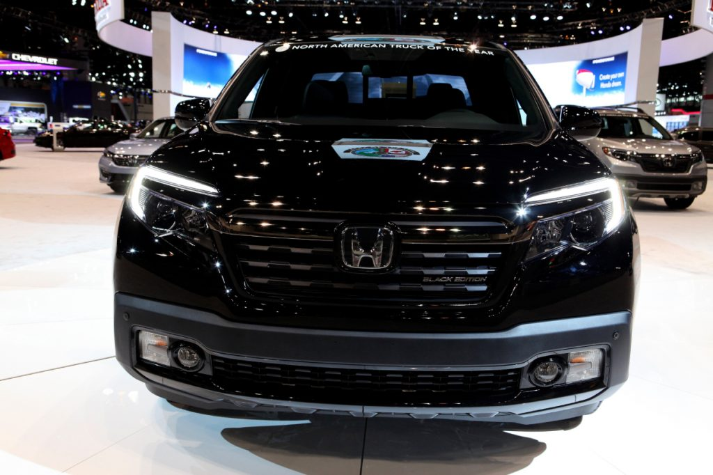 A black Honda Ridgeline on display at an auto show