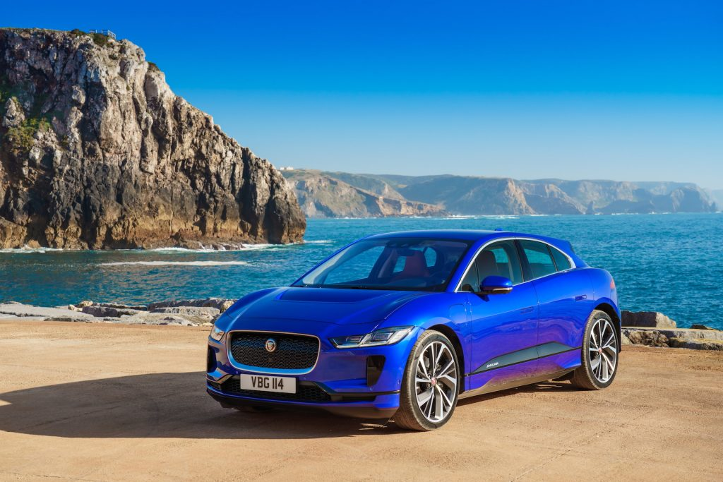 An image of a Jaguar I-Pace parked by the sea.
