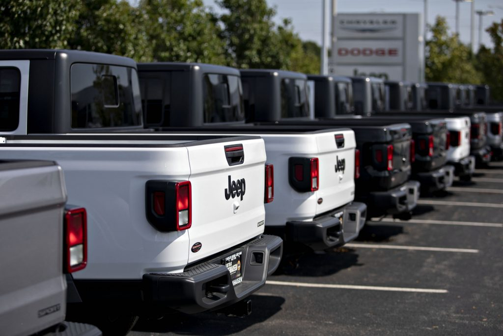 Fiat Chrysler Automobiles NV 2020 Jeep Gladiator pickup trucks are displayed at a car dealership