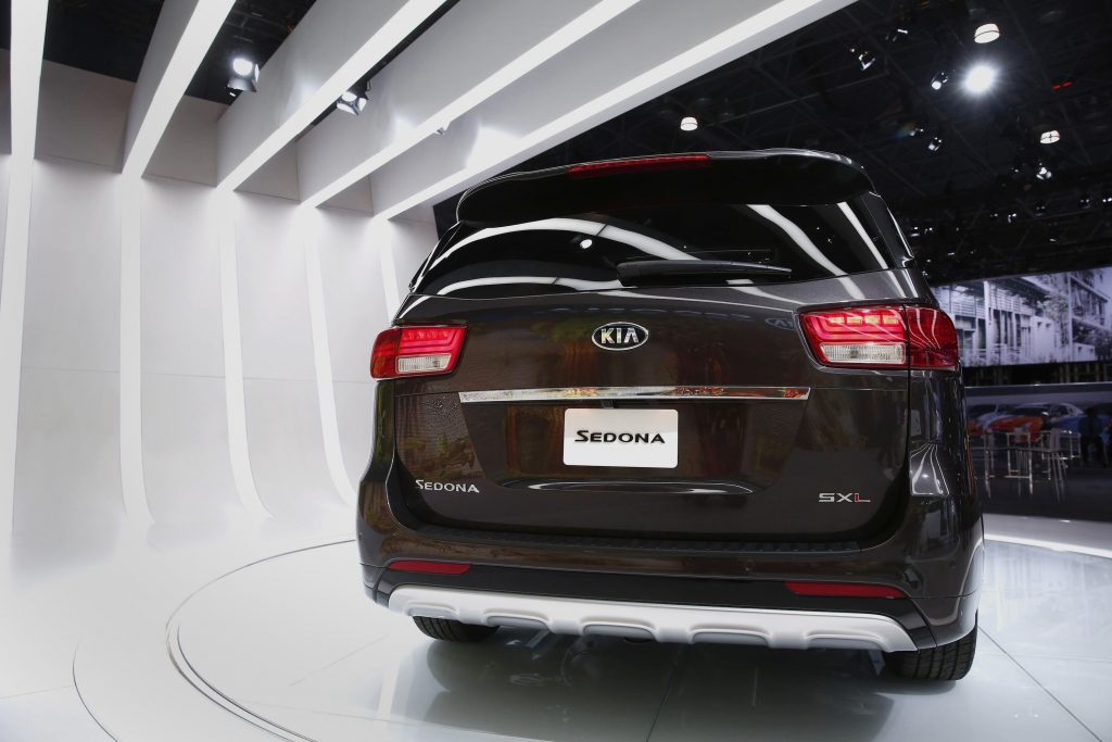 A Kia Motors Corp. 2015 Sedona minivan is displayed during the 2014 New York International Auto Show from the rear of the vehicle