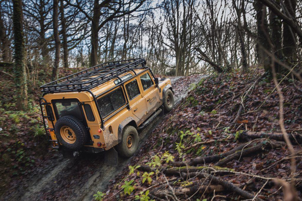 An image of a Land Rover Defender Trophy V8 off-roading.