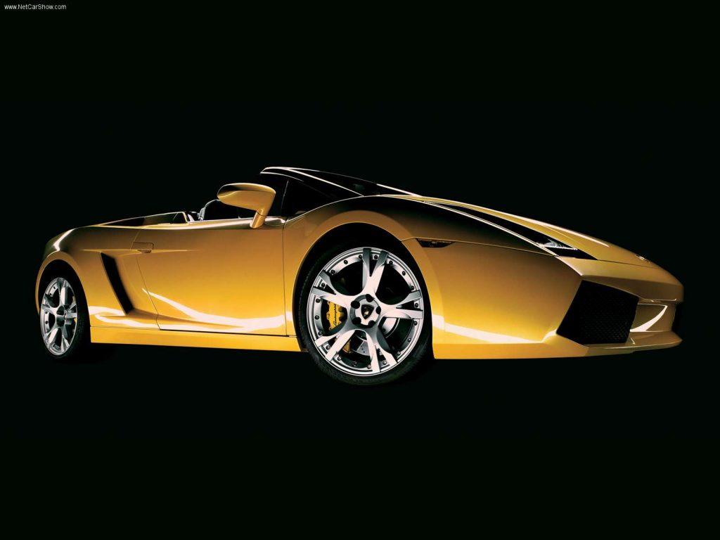 An image of a yellow Lamborghini Gallardo in a studio.