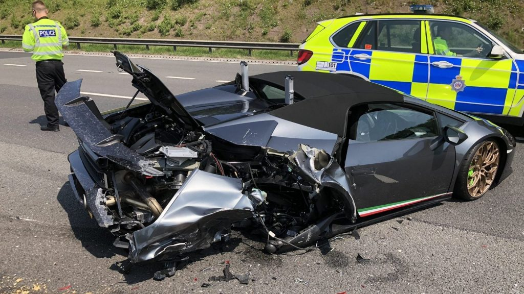 A wrecked Lamborghini Huracan Preformante Spyder sits on the M1
