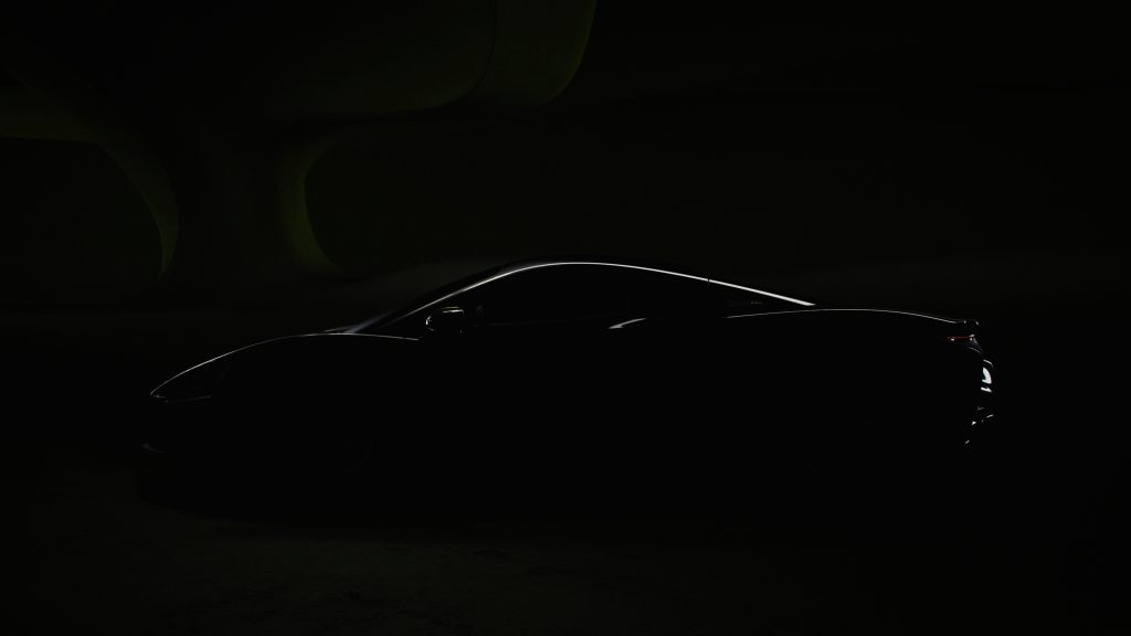 A dark imagine hiding everything about the 2022 McLarent Artura besides a sliver of light that highlights the car's silhouette