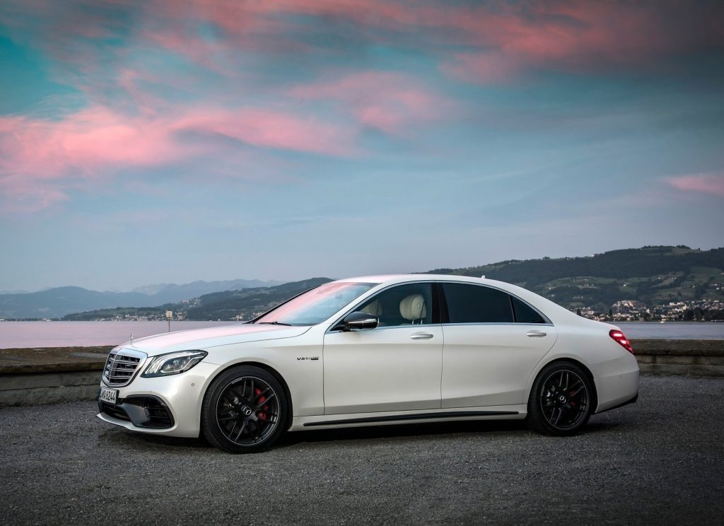 An image of a white Mercedes-Benz S63 AMG parked outdoors.