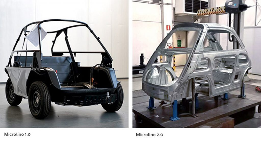 The black tubular chassis of the Microlino 1.0 next to the steel-and-aluminum monocoque of the Microlino 2.0